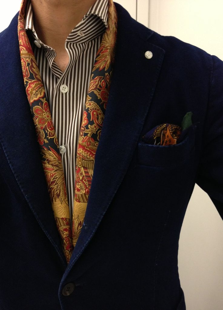 ~Would have the scarf inside the shirt....Has it down very nicely, the dark navy blazer + navy striped shirt & pop of patterned gold.