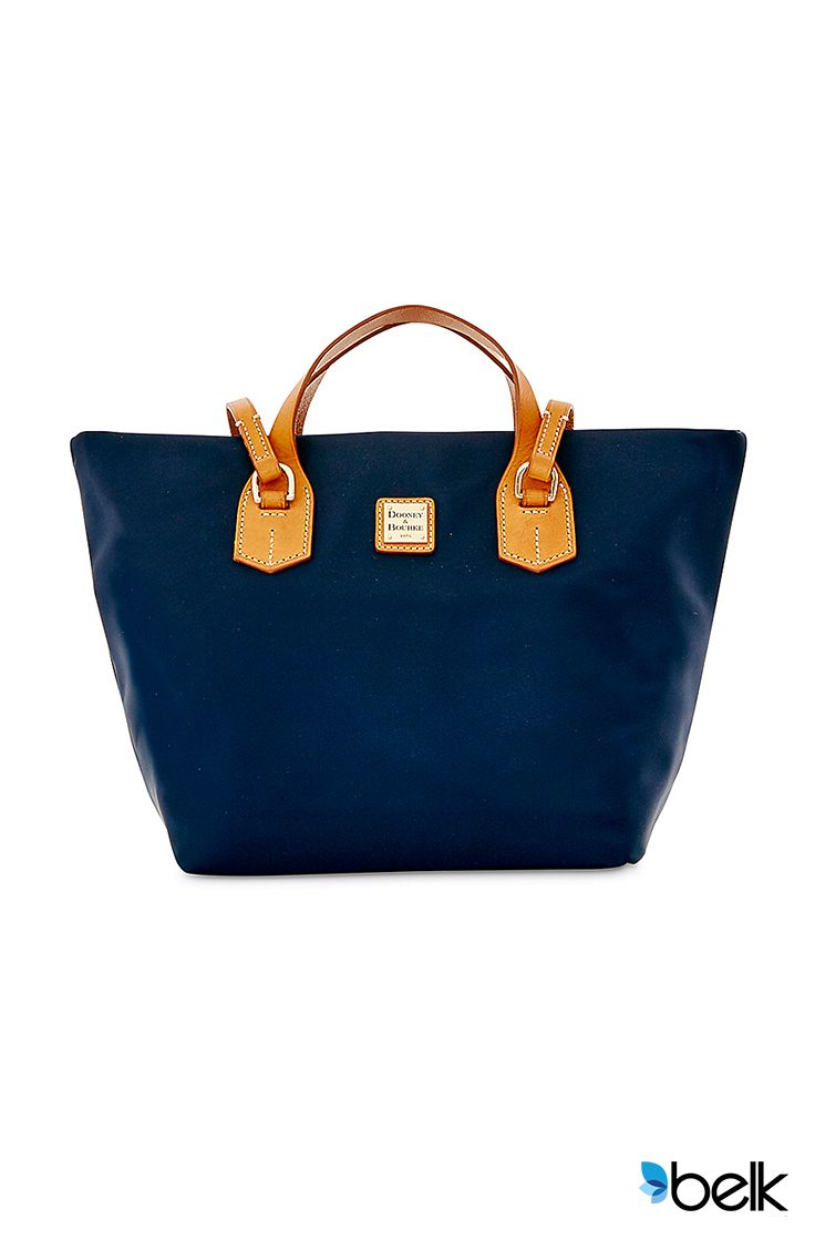 Add some modern flair to your wardrobe this summer with the Dooney & Bourke Leighton Tote. It's more than just a nylon, versatile accessory with a sophisticated silhouette, it's a chic but functional staple that can take you from the office to a day at the beach – or anywhere in between. Pick up one in blue, pink, beige or black at Belk.com.