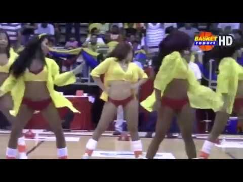 Sexy Cheerleader dancing in basketball game at halftime