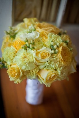 GORGEOUS, yellow bridal bouquet featuring yellow roses, yellow carnations, and white hypericum berries. Photographer: Kristen Gardner Photography