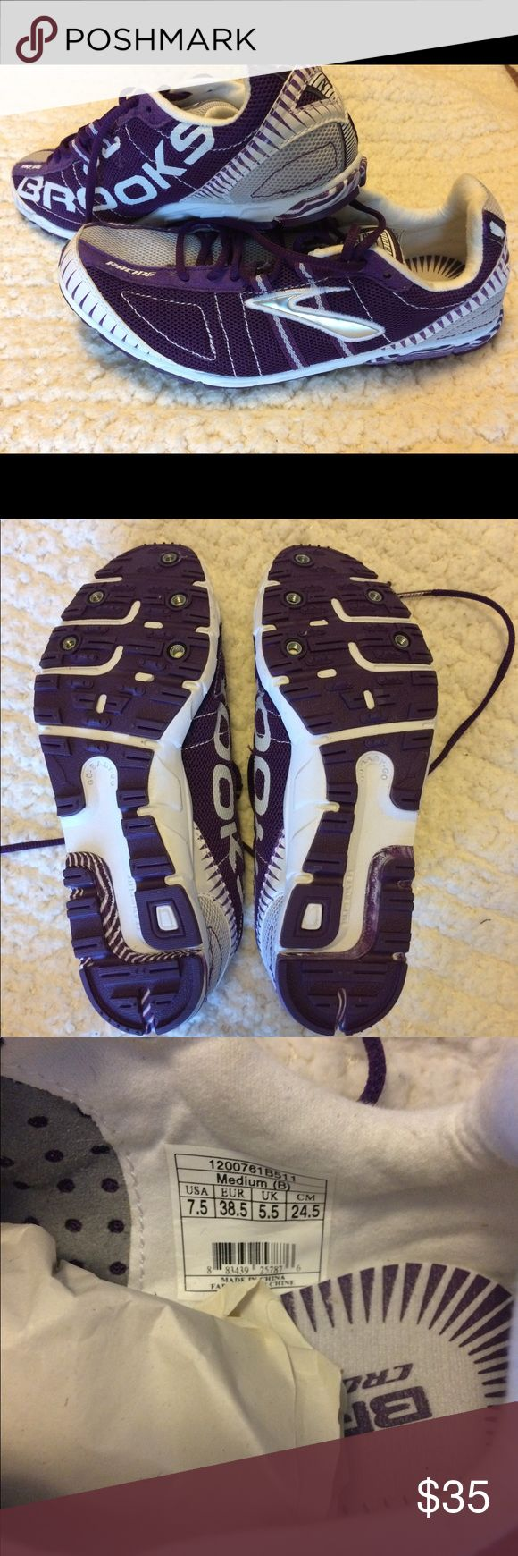 Brooks Running Spikes Women's size 7.5 brand new without tags. Comes with shoes only...no metal spikes included. Purple and white colored Brooks Shoes Athletic Shoes