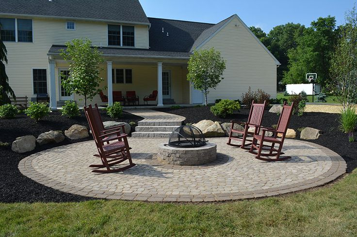 Enjoy an evening with friends around a cozy fire pit. We used Techo Bloc Antika Pavers with a Villagio Border and a Techo Bloc Valencia Fire Pit.