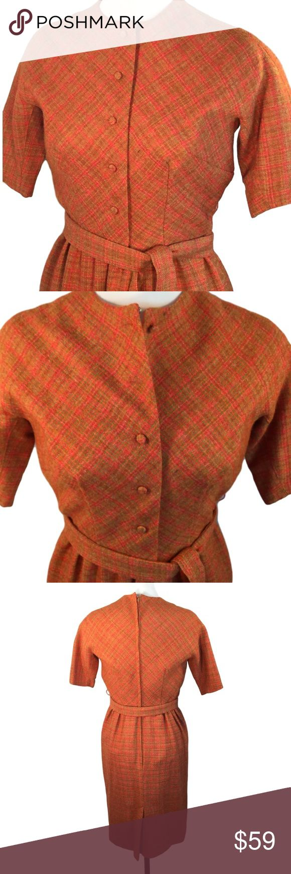 """60s Worsted Wool Fitted Bodice Dress Belt Tie S E.T. Jrs  Orange Tweed Worsted Wool Blend Dress Fitted button front bodice and matching tie belt Front has covered buttons, button front bodice  Metal Zippered Back 3/4 Dolman Sleeve Fully lined in bright orange and in very nice condition Small / pictured on size 6 mannequin and fits snug  Condition is very nice with no holes  ✂------measurements------- (all taken with the garment laying flat)  Chest 19""""  Length back to waist 16"""" to Hem 41""""…"""