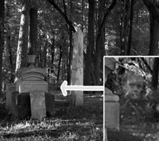 This amazing paranormal pictures was taken in an old civil war era cemetery in Gettysburg, Pennsylvania . The photographer was taking pictures of the hauntingly eerie graveyard but it was only when he reviewed his images later that he noticed the semi-transparent shape of child's face peering out from behind one of the graves.
