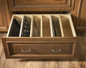 Drawer for baking pans so you don't have to get them all out when you need just one.