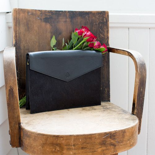 Roma Bag, black leather fold over bag with fur and detachable strap.  Converts to an oversized clutch! www.littleghost.co.nz