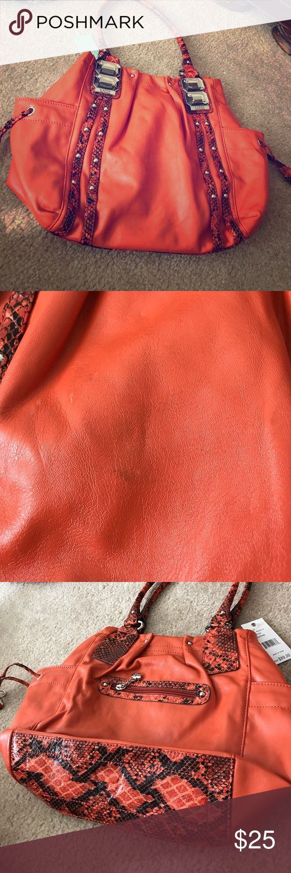Kathy van Zeeland orange leather & snake print bag Kathy van Zeeland orange leather and snake print purse/bag; NWT. Some scuffs from storage, but they huge. Possibly able to buff out. Kathy Van Zeeland Bags Hobos