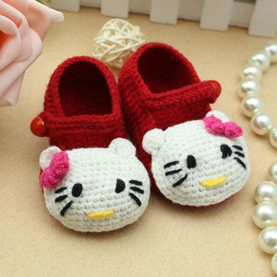 red Handmade Crochet Baby Booties white hello kitty style girl  baby shoes  strap with button. $9.99, via Etsy.