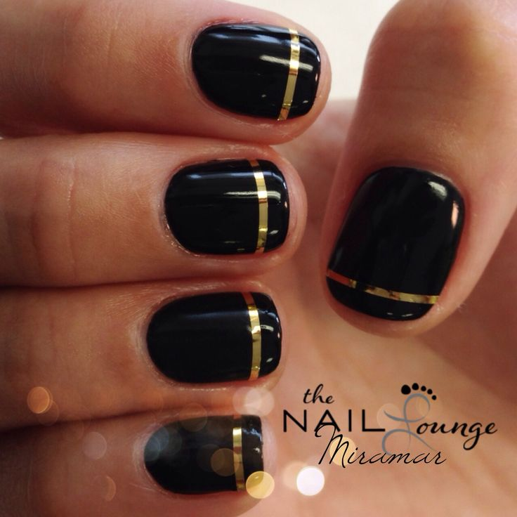 Simple black gel manicure with gold strip