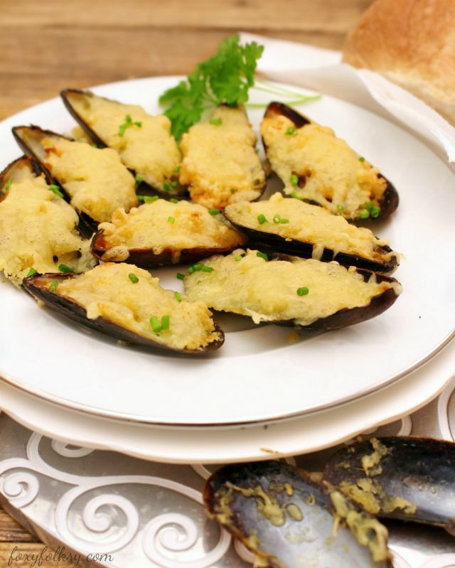 This Cheesy Baked Mussels are perfect appetizers and it is so easy to prepare too. The combination of butter, garlic and cheese added to the mussels just makes this dish simply delightful.  www.foxyfolksy.com