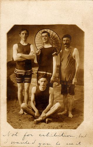 Four men in vintage swimwear, circa 1910