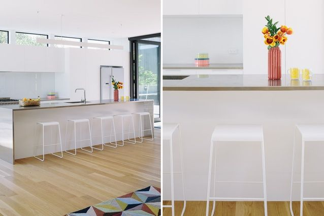 The kitchen is open to the dining and lounging areas. - pair back and let the architecture sing