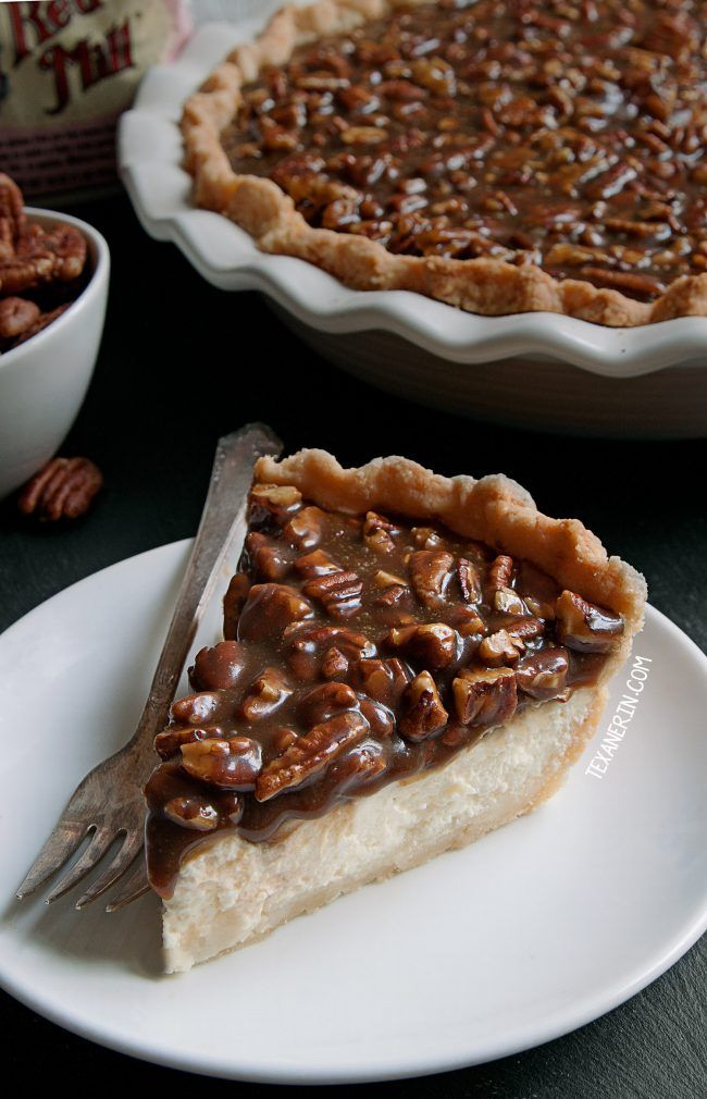 This caramel pecan cheesecake pie has a layer of caramel pecans over a cream cheese filling. With gluten-free, whole grain and all-purpose flour options. Perfect for Christmas and  Thanksgiving!