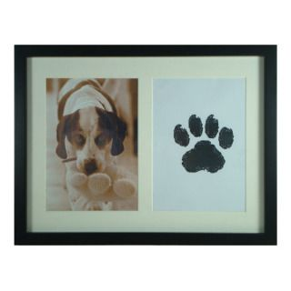"""An adorable frame where you can put a pic of your pet and its paw print.<br /><br />$14.99, <a href=""""http://www.kohls.com/product/prd-1475570/sonoma-life-style-pet-pawprint-5-x-7-frame.jsp"""">Kohl's</a>"""