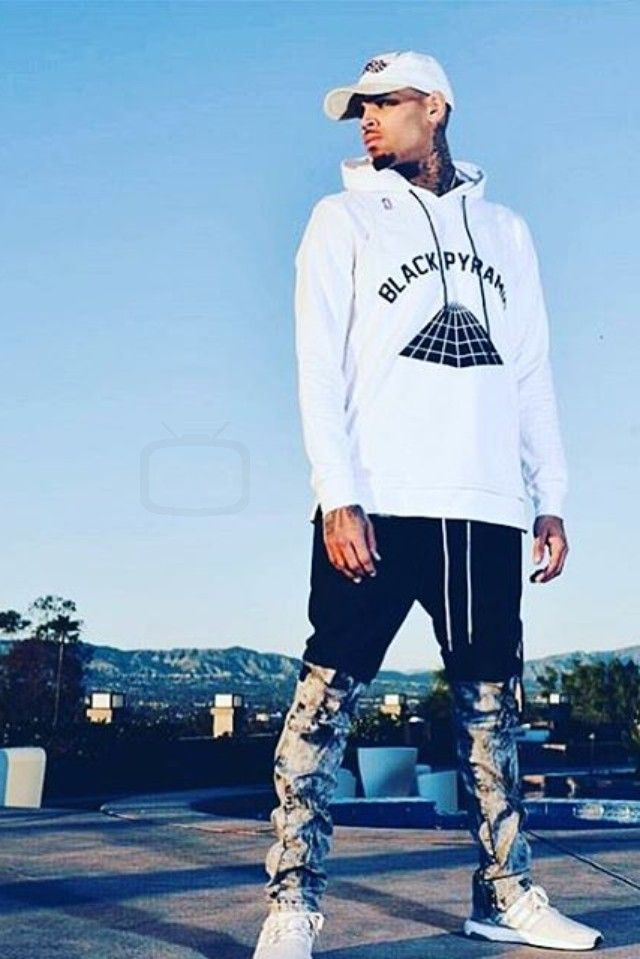Chris Brown wearing  Black Pyramid Mixed Media Pants, Black Pyramid Signature Hoodie, Adidas Ultra Boost Sneakers