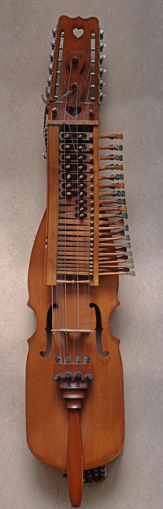 """A Nyckelharpa. A traditional swedish instrument that literally means """"keyed fiddle"""". Never seen one but I imagine it sounds as unique as it looks."""