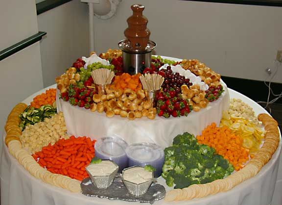 Chocolate fountain, fruit, veggies, bread, cheese and ...