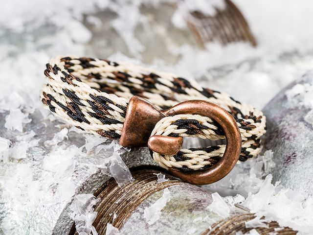 """16 strand kumihimo; interesting clasp, but would worry that it could easily become unhooked when wearing. Would look nice in different colors. """"Big City Kitty Bracelet"""""""