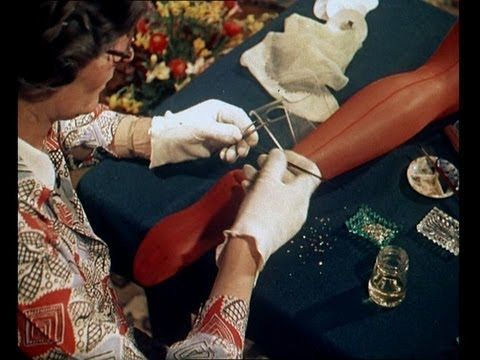 "Hosiery Fashions - Bejewelled Stockings (1950s Trend Footage)    Taken from the British Pathe reel ""Jewelled Stockings"" (1955) in the free online film archive http:///www.britishpathe.com    The ladies applying the jewels are Gwen Dopson and Mrs. Jackson. The artist is Mr. Bert Price. This video was filmed on location in Uxbridge, Middlesex by B..."