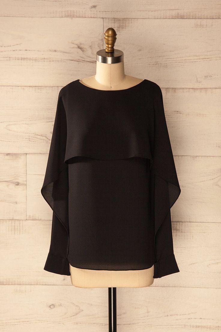 Elle prit son envol dans la nuit silencieuse.  She took flight in the silent night. Medby Black - Cape sleeves blouse www.1861.ca