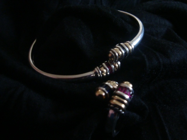 Material: silver, gold, sapphire and ruby