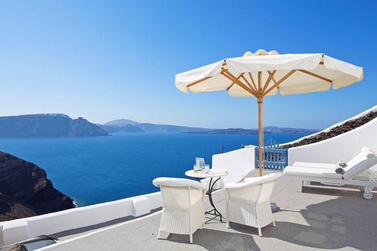 Wake up and enjoy your morning coffee with amazing panoramic views at the Canaves Oia Villa