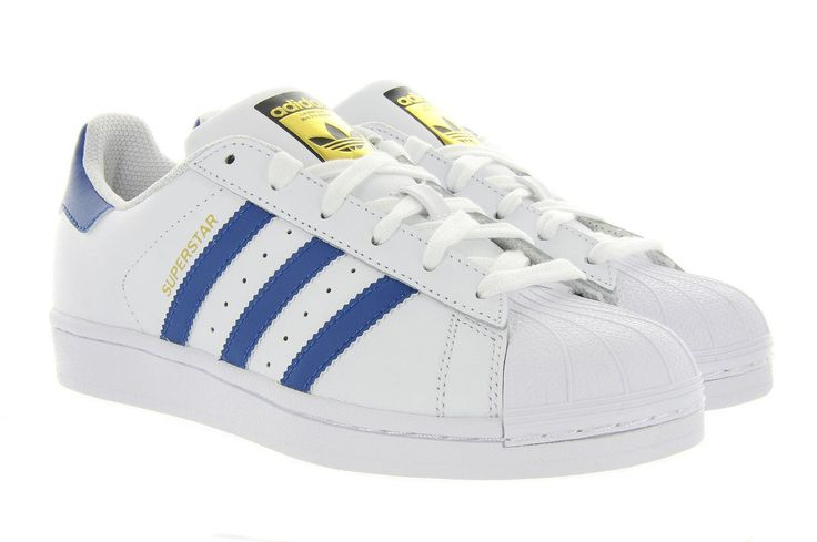 Adidas sneakers Superstar ba8380/S74944 Blauw, Deze stoere unisex sneakers van het model Superstar is wereldberoemd, en wordt nog steeds gedragen door alle bekende sterren. De upper is gemaakt van wit leder met blauwe accenten. De tong is afgewerkt met een rubberen toplaag.