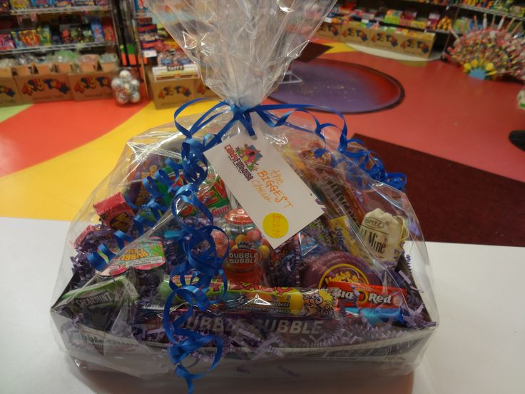 """""""The Biggest Chew"""" Even the most devoted gum-chewers might be a little winded after chomping through every single last morsel of all kinds of retro and new gums available in this gift basket!"""