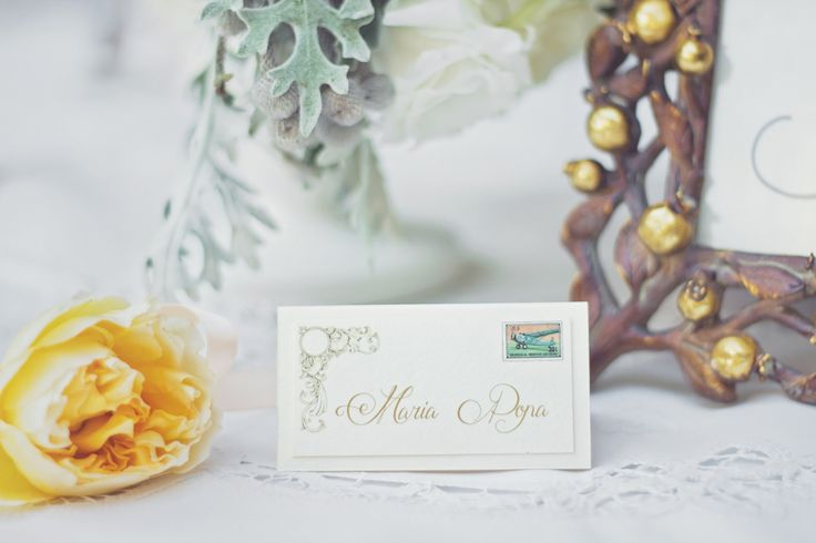 Beautiful place card idea for travel theme wedding