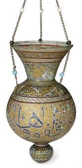 A large gilt and enamelled clear glass mosque lamp, Ottoman Syria, 19th century.