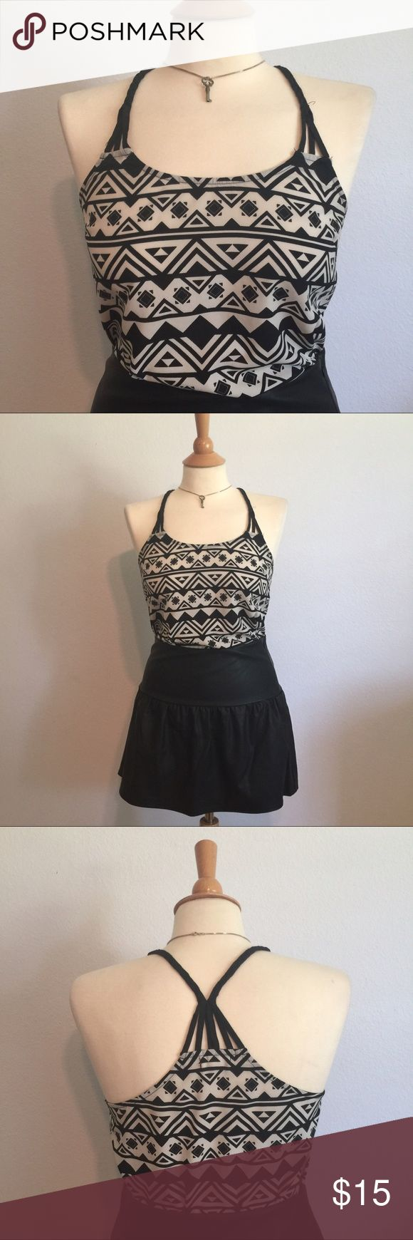 Aztec print braided Strappy back flowy tank S Super cute black and white Aztec print tank! This is light and flowy and perfect for summer! Cute straps with strappy back and braided straps! Cute with jeans or tucked into a skirt! Size small. Brand e (hanger) m. Gently used but no noticeable flaws! e (hanger) m Tops Tank Tops