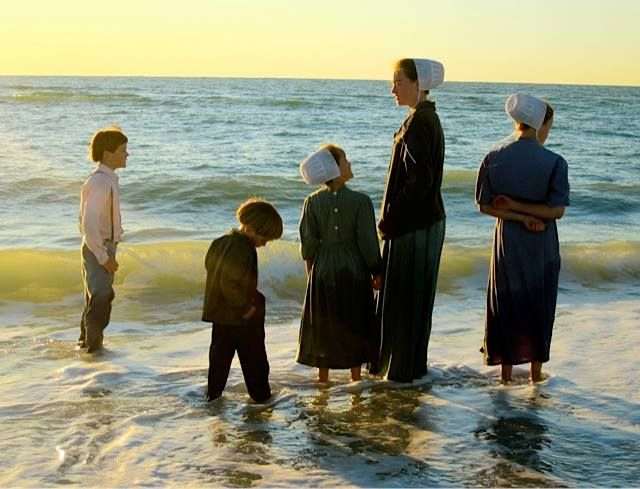 Amish children on the beach in Florida