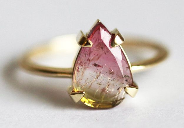 A watermelon tourmaline ring featuring what look like suspended magical particles. | 31 Stunning Engagement Rings That Aren't Made With Diamonds