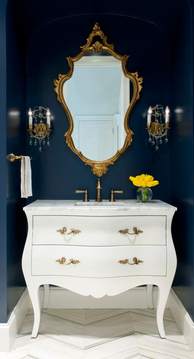 Bathroom drama. Bombay chest in gloss white, dark walls, gilded mirror. The 2016 Kitchen and Bathroom Handbook