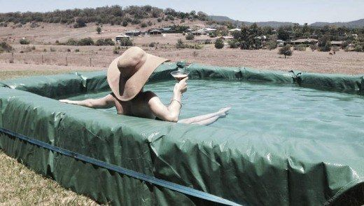 This Swimming Pool made from Hay Bales and a Plastic Sheet is an easy DIY that will give you hours of enjoyment!