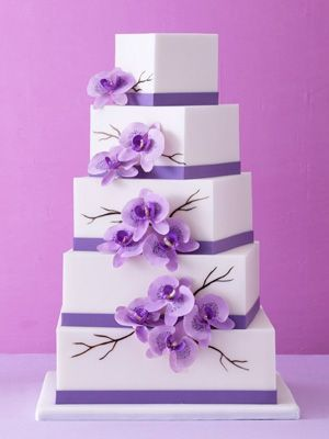If you like square cakes,you could do something like this with hot pink, orange, yellow flowers and black bands.