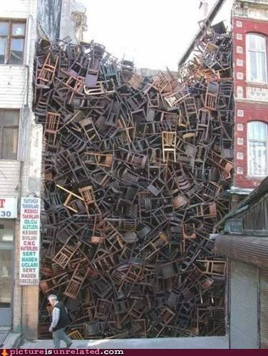chairs!  An art installation by artist Doris Salcedo. Created in 2003 in Instanbul, comprised of over 1600 chairs! Amazing!