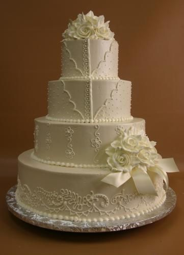 How 'bout just a lovely white one for a change? :)   (Konditor Meister Elegant Wedding Cakes)