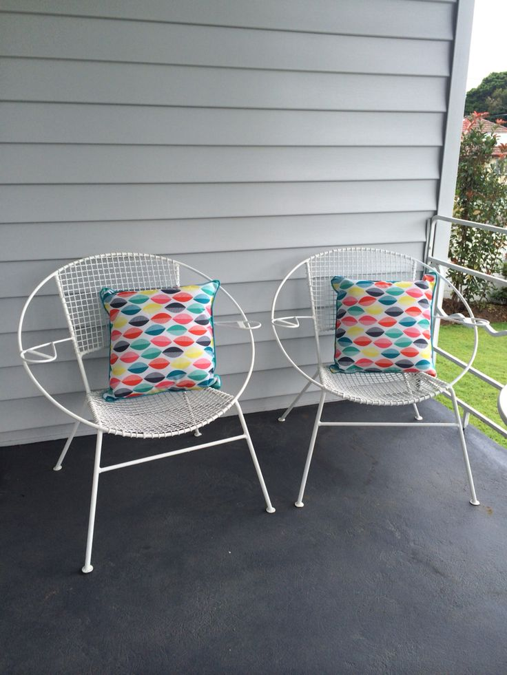 Original restored saucer chairs with K Mart outdoor cushions on the front porch