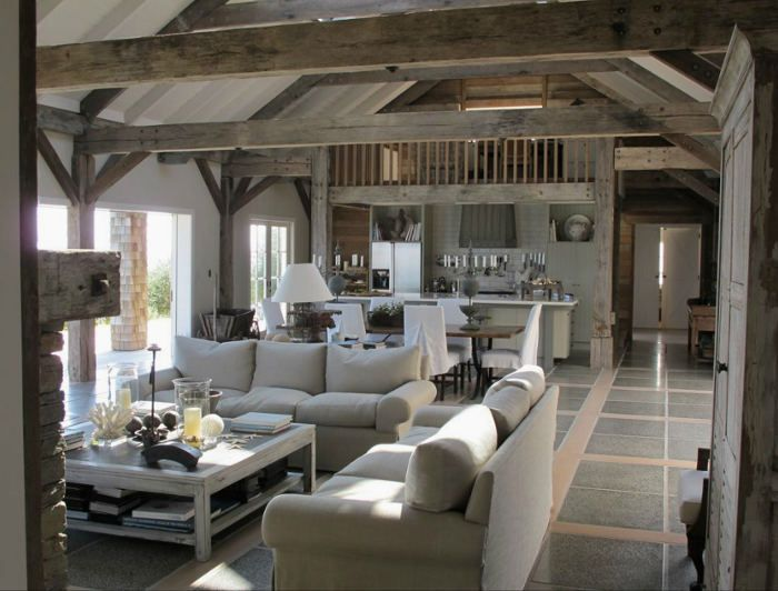I LOVE exposed beams, especially in this color. Great way to carry the grey wood color through the home with small splashes of color.