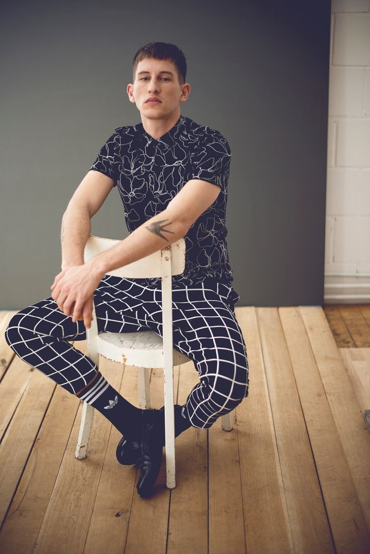 Mixing patterns, Jannik sports a black and white Topman shirt with Adidas socks, Zara Man's shoes. Jannik also sports pants from Vera Witthaut's personal collection.