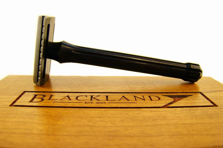 Solid cherry wood box with Blackbird - a black safety razor machined from stainless steel. All made in the USA. Blackland. #wood #wetshaving #shave