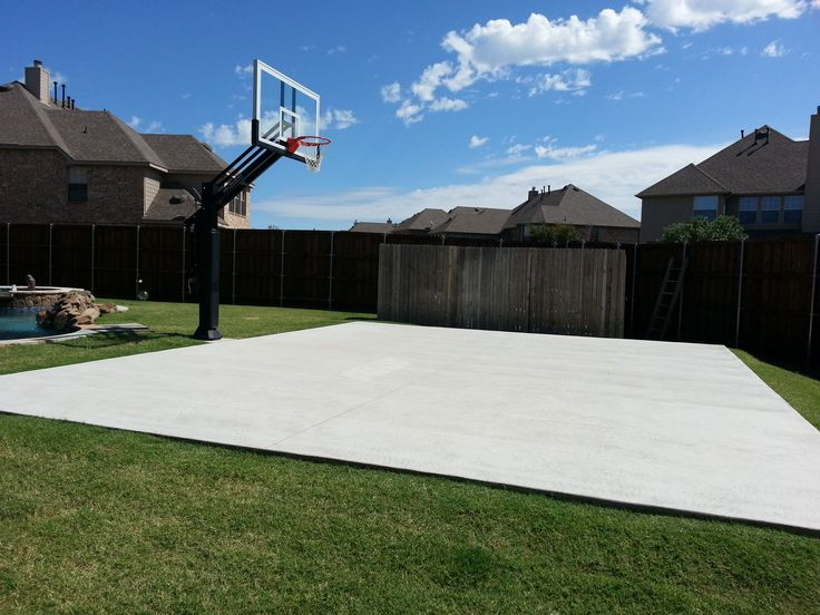 There is Mark's concrete slab court in his backyard next to his Pro Dunk Gold Basketball System.