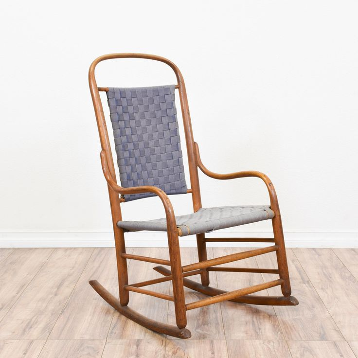 This rustic rocking chair is featured in a bentwood with a glossy oak finish. This vintage rocker is in great condition a curved back, curved arms and purple blue woven fabric. Simple chair perfect for a covered porch or patio! #rustic #chairs #rockingchair #sandiegovintage #vintagefurniture