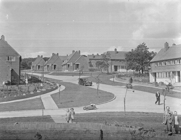 67542 - General view of new houses in a housing estate at Esh Winning. Note children in the foreground playing with a pedal car. 4th August 1950.