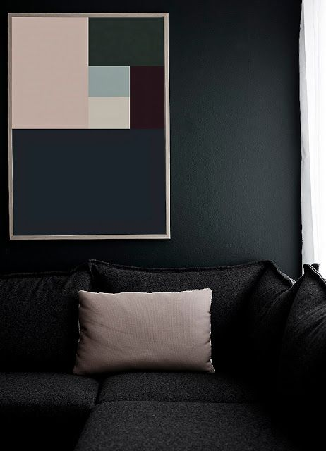 Clever! Dark walls and cushions mirroring the geometric artwork.