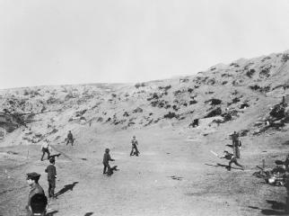 "CRICKET DURING THE FIRST WORLD WAR  part of ""AUSTRALIAN FORCES IN GALLIPOLI 1915 - 1916"" (photographs) Made by: Australian official photographer 1915-12-17  Leisure and entertainment at the Front: A game of cricket being played at Shell Green - the only game of cricket played on the Gallipoli peninsula. Major George Macarthur Onslow of the Light Horse, batting, is being caught out. Shells were passing..."