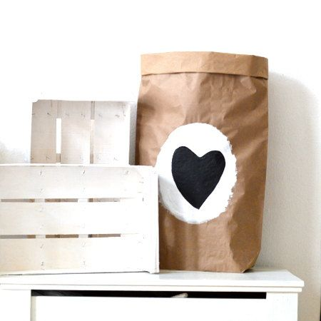 Hand painted paper storage bag with a black heart. You can storage lots of things in it: toys, books, magazines, wrapping paper rolls, dog food, yarns,