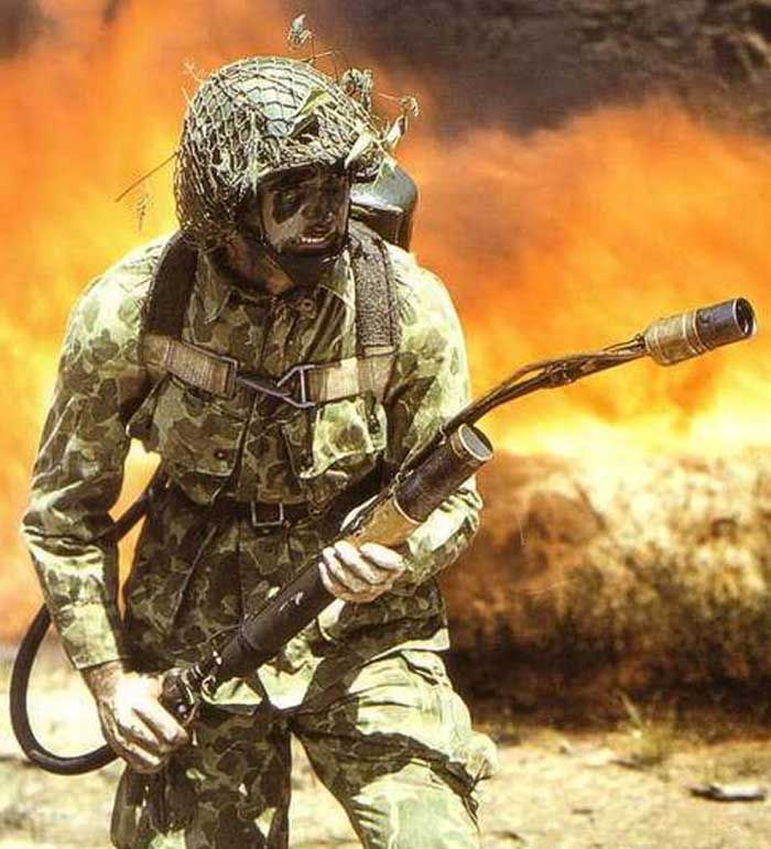 us army paratrooper with the m1942 camo uniform using a