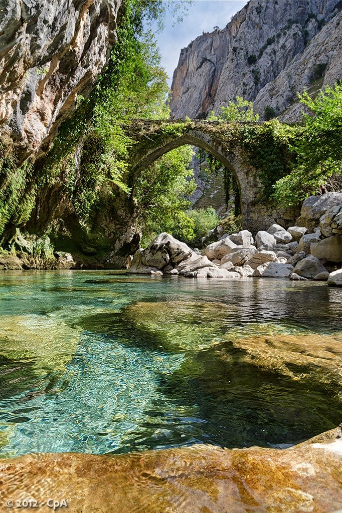 Jaya medieval bridge over Cares river heading to Bulnes, Asturias, Spain
